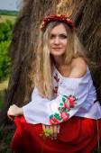 Ukrainian beautiful woman in the hayloft — Stock Photo