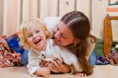 Mother and son playing on the floor in a country house — Stock Photo
