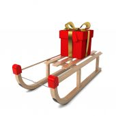 Wooden sledges with gift box — Photo