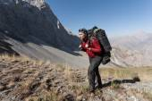 Hiker in high mountains. — Stock Photo