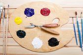Palette with oil paint and brushes — Stock Photo