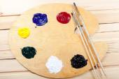 Palette with oil paint and brushes. — Stock Photo