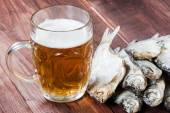 Beer glass and dried fish. — Stock Photo
