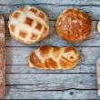 Various Bread Types On Wood Background — Stock Photo #65638427