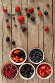 Red Fruits In Ceramic Bowls — Stock Photo
