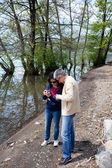 Couple Watching Photos Taken With Smartphone — Stock Photo
