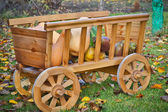 Harvest pumpkins in a wooden cart — Stock Photo