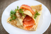 Stack of pancakes with salted salmon — Stock Photo