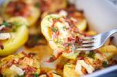 Baked potato with bacon and cheese — Stock Photo