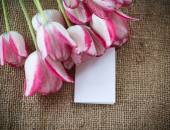 Bouquet of tulips on an old table — Stock Photo
