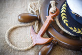 Decorative wooden ship anchored at the helm — Stock Photo