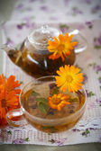 Herbal tea with marigold flowers — Stock Photo