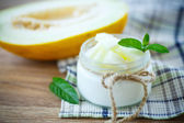 Yogurt with melon — Stock Photo