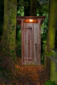 Wooden dry toilet house at night in the forest — Stock Photo