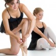 Two beautiful young girls preparing for dance training together — Stock Photo #52154855