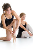 Two beautiful young girls preparing for dance training together — Stok fotoğraf