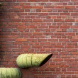 Brick wall with pipes background — Stock Photo #52576037