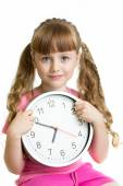 Girl displaying seven o'clock time in studio isolated — Foto de Stock