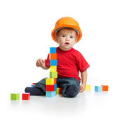 Little kid in hard hat with building blocks — Stock Photo