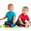 Happy children playing by mallet or hammer — Stock Photo #54019901