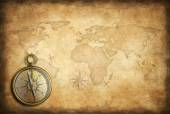 Old brass or golden compass with world map background — Stock Photo