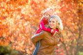 Happy parent and kid family walking together outdoor in fall par — Stock Photo