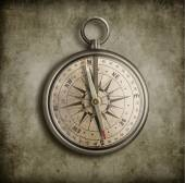 Old compass over vintage background — Stock Photo