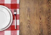 Dinner table with setting plate top view — Stockfoto