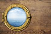 Ship or boat porthole on wooden wall — Stock Photo