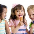 Happy kids eating ice cream in studio isolated — Stock Photo #55119999