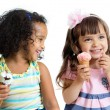 Happy kids two girls eating ice cream isolated — Stock Photo #55164503