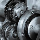 Gears and cogs of old machine — Stock Photo