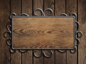 Old wood plate or sign in metal frame on vintage door — Stock Photo