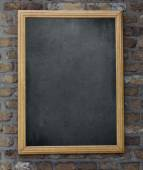 Aged menu blackboard hanging on brick wall — Zdjęcie stockowe