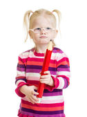 Funny serious kid in eyeglasses with red pencil isolated — Stock Photo