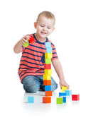 Kid playing and building high tower with colorful blocks isolated — Foto Stock