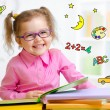 Happy child in glasses reading book. Early education in kindergarten concept. — Stock Photo #64303911