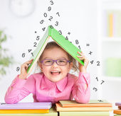 Smart kid in glasses under falling digits — Stock Photo