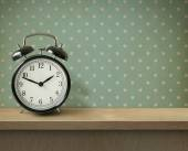 Alarm clock on table or shelf background — Stock Photo