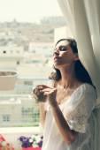 Woman near window — Stock Photo