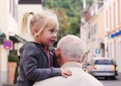 Grandfather holding his granddaughter — Stock Photo