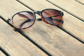 Sunglasses on wood — Stock Photo