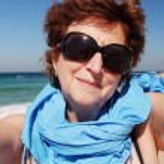 Happy senior woman on beach — Stock Photo #63972787