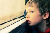 Boy looking through window — Stock Photo