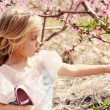 Little Girl Holding Flower — Stock Photo #69612217