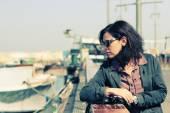 Woman walking in sea port — Stockfoto