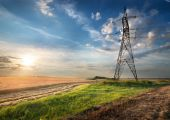 Electric pole in the field — Stock Photo