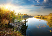 Old pier on autumn river — Stock Photo
