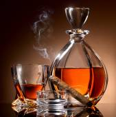 Alcohol and cigar — Stock Photo