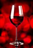 Wine on red background — Stok fotoğraf